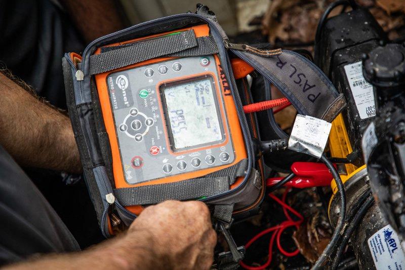 Technicians testing pump